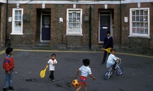 Bengali children playing on Spitalfields council housing estate, Tower Hamlets, East London UK