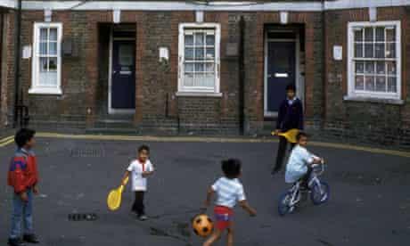 Bengali children playing on Spitalfields council housing estate, Tower Hamlets, East London UK