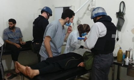 U.N. chemical weapons experts visit people affected by an apparent gas attack, at a hospital in the southwestern Damascus suburb of Mouadamiya.