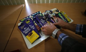 Media help themselves to samples during a tour of the Cadbury factory in Tasmania this morning, Wednesday 28th August 2013