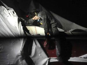 Boston Marathon pics: Dzhokhar Tsarnaev slumped over the side of the boat where he was cornered