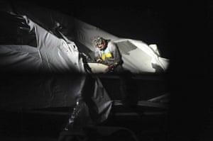 Boston Marathon pics: Dzhokhar Tsarnaev climbing out of the boat where he was caught