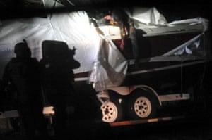 Boston Marathon pics: Police train weapons on Dzhokhar Tsarnaev as he surrenders.