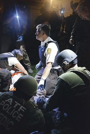 Boston Marathon pics: Officers prepare to stretcher Dzhokhar Tsarnaev away from the scene