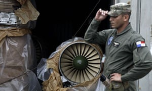 A navy policemen guards a Russian fighter jet engine