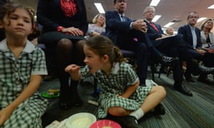 A school girl enjoys her breakfast ahead of Prime Minister Kevin Rudd (right) addressing the Queensland Teachers' Union in Brisbane, Wednesday, Aug. 28, 2013.