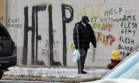 man walks along Detroit street