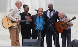 With Trayvon Martin parents, Sybrina Fulton, and Tracy Martin, Peter Yarrow, left, and Paul Stookey, right, of the folk trio Peter, Paul and Mary, perform at the 50th Anniversary of the March on Washington.