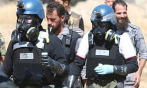Meanwhile UN chemical weapons experts wearing gas masks carry samples from one of the sites of an alleged chemical weapons attack in the Ain Tarma neighbourhood of Damascus.