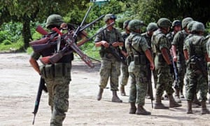 Mexico: a soldier holds weapons after a disarmament operation