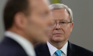 Kevin Rudd listens to Tony Abbott during the second Sky News People's Forum at Rooty Hill RSL in Sydney.
