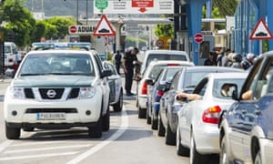 Guardia Civil officer carry out checks at the border between Spain and Gibraltar