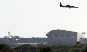 A military plane flys over Akrotiri RAF airbase near Limassol, Cyprus, on 28 August 2013.