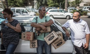 Israelis wait in line to pick up and change gas masks at the central post office in Tel Aviv, Israel, 29 August 2013.