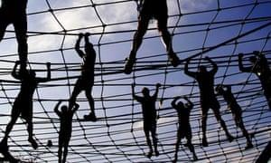 Athletes crossing a rope bridge