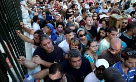 Israelis queue to collect gas mask kits in Haifa