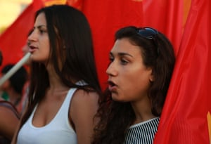 Members of the Greek Communist Party march with a flag in front of the Parliament in Athens during an protest against any military action by the U.S. and its allies against Syria on Thursday Aug. 29, 2013. (AP Photo/Dimitri Messinis)