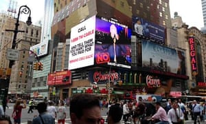A CBS advertisement in Times Square asks customers to complain to Time Warner Cable over blackouts