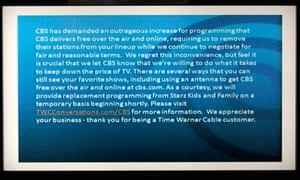 A television screen shows the CBS channel with an announcement by Time Warner Cable