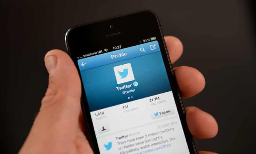 """Twitter app being viewed on an iPhone as Twitter has introduced a """"report tweet"""" option for users who are sent abusive messages following a campaign by a number of women who were targeted on the site."""