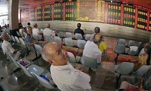 Investors in Shanghai monitoring stock information