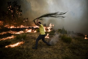 Wildfires in Portugal: TOPSHOTS A local tries to extinguish a w