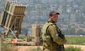 An Israeli soldier is seen next to an Iron Dome anti- missile rockets launcher.
