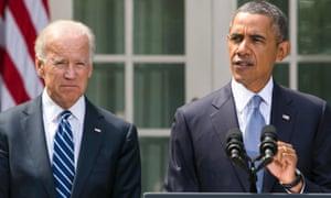 Barack Obama, accompanied by Joe Biden.