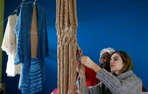 Prison knitting: Raquel Guimaraes supervises a prisoner knitting for her
