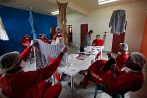 Prison knitting: Raquel Guimaraes (centre, standing) supervises prisoners knitting for her