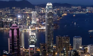 All lit up: Victoria Harbour in Hong Kong with residential and commercial buildings including the International Finance Centre Two (centre).
