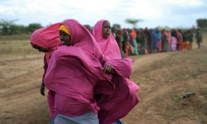 This photograph, released by the African Union-United Nations Information Support Team A, shows internally displaced women lining up for food at a distribution centre in Afgoye, Somalia.