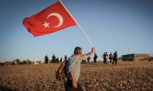 Riot police run to stop a man walking with a national flag outside the Silivri jail complex in Turkey. Some 275 people, including military officers, politicians and journalists, are facing verdicts in a trial over an alleged conspiracy to overthrow the government of Recep Tayyip Erdogan