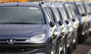 Peugeot cars in a line