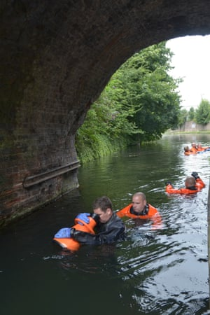 Officers use an Aqua Scope to search under a bridge in a canal for any evidence that may help to identify a woman who was found dead in the canal on 24 July in Wolverhampton, England.