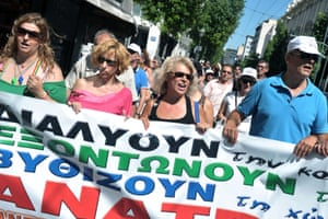 Employees of social security offices and the national Manpower Employment Organization, which assists the unemployed, protest outside the Ministry of Labour in Athens on August 5, 2013.