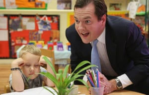 George Osborne with a lad called Titas (who seems to be dreaming about the summer hols) during a visit to a nursery in Hammersmith, London, to announce the government's plans to give tax breaks worth £1,200 per child to families