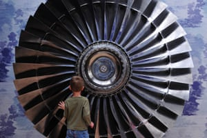 Elia Lemanski, 4, stands next to a 1970 Rolls Royce Titanium Turbine Fan at Christies auction house in London. The fan is part of the 'Out of the Ordinary' sale on 5 September, it's expected to fetch between £60,000-80,000.