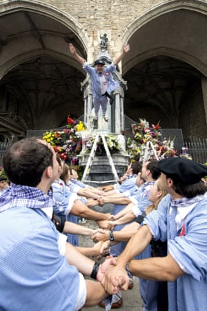 People hold hands as they wait for a reveller to jump during the Virgen Blanca Festivity in Vitoria, northern Spain. The festivities take place from 4 to 9 August each year to honour the Virgen Blanca, patron saint of the city