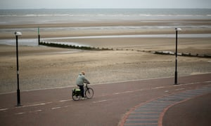 A wet and gloomy promenade in Rhyl, Wales. The think tank The Centre for Social Justice (CSJ) has today said that some British seaside towns such as Rhyl were becoming 'dumping grounds' for vulnerable people.