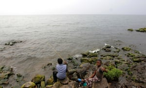 Another shoreline, another continent: Congolese boys fish on the shore of Lake Kivu in Goma, eastern Democratic Republic of Congo.