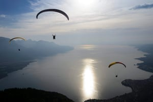 Acrobatic paragliders fly during a press preview of the upcoming Acroshow in Villeneuve, above the Geneva Lake, Switzerland. The acroshow is a paragliding acrobatic competition and will run from 23 to 25 August. Photograph: Laurent Gillieron/EPA