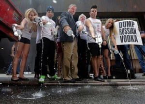 Vodka boycott: President Paul Hurley, third left, of the United Restaurant and Tavern Owners Association, leads a protest by dumping Russian vodka on a New York street. The association is joining with LGBT activists to push for a ban on all Russian spirits, liquors and food in bars, cafes, taverns and restaurants around the city. Photograph: Richard Drew/AP
