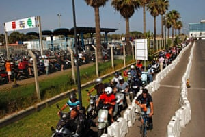 """Bordeline tensions: Workers wait in line with their motorcycles and scooters to enter Spain at its border with the British territory of Gibraltar, south of Spain. Tensions over Gibraltar escalated when the British territory's chief minister accused Spain of """"sabre-rattling"""" and behaving like North Korea after Madrid floated the idea of a new border crossing fee and airspace controls. Photograph: Jon Nazca/Reuters"""