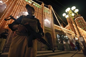 Pakistani policemen stand guard during special Taravih prayers, during the 27th night of Ramadan, at a mosque in Peshawar. According to the Muslims' belief the night Lailatul Qadar falls in the odd nights of the last ten days of Ramadan. Lailatul Qadar is the night in which the revelation of the holy Koran was initiated. Photograph: Arshad Arbab/EPA