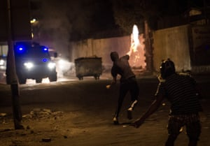 Protesters use Molotov cocktails try to stop an armored vehicle from entering the village of Abu Saiba to make arrests as clashes took place ahead of a planned countrywide anti-regime protest on August 14, organized by Bahrain's 'Tamorrod' movement. Photograph: Ahmed Al-Fardan/Demotix/Corbis