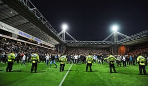 And soon after the pitch invasion by Preston fans police officers form a defensive line. Photograph: Action Images