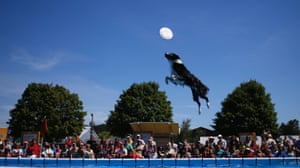 """Aero leaps over a pool for a disc while performing in the """"K9's in Flight"""" dog show, at the New Jersey State Fair Sussex County Farm and Horse Show in Augusta, United States. Photograph: Mike Segar/Reuters"""