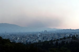 A cloud of smoke from a forest fire at Varibobi suburb rises in the sky over Athens August 6, 2013.