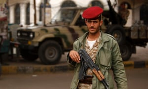 An army trooper looks on, while manning a checkpoint in Sana'a, Yemen.